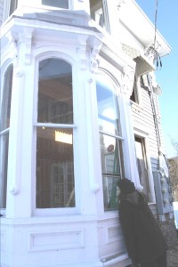 Last March, Worcester Supervisor Diane Addesso peered through the window of the building next to the Weiting Building that is being renovated into a new library.  (File photo/allotsego.com)