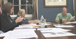 "Trustee Cindy Falk, left, seeks to convince her colleague of the wisdom of a ""hospital zone,"" but ended up as the sole ""aye"" in a procedural vote."