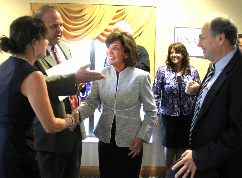 Kathy Hochul, Governor Cuomo's runningmate for lieutenant governor, is in Otsego County this evening for the annual Jedediah Peck Dinner at the Country Inn & Suites  in Hartwick Seminary.  Here, county Chairman Richard Abbate introduces the candidate to former Oneonta Mayor John Nader, at left is Kim Muller, Nader's predecessor.  Congressional candiidate Sean Eldridge was also in attendance, and state Controller Tom DiNapoli was due to deliver the keynote.  The guest of honor was Bill Streck, retired Bassett Healthcare president/CEO and a prominent local Democrat.  (Jim Kevlin/allotsego.com)