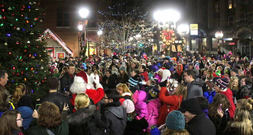 With the help of the crowd, Acting Mayor Russ Southard and Santa Claus light the Christmas tree in Muller Plaza on Thursday night.