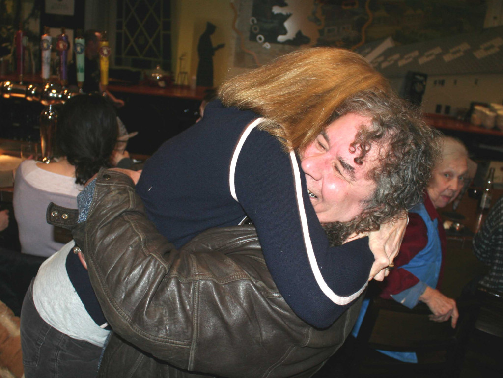 "Otsego 2000 President Nicole Dillingham gives a big hug to fellow fracking foe Bob Eklund at a celebration now underway at Cafe Ommegang following today's news that Governor Cuomo is banning fracking in New York State. ""This is historic, this is euphoria,"" Dillingham said when more formal remarks were solicited during the gathering. ""This is not for us. This is not for our families. This is not for our children,"" Eklund said of the controversial fracking process. (Jim Kevlin/The Freeman's Journal)"