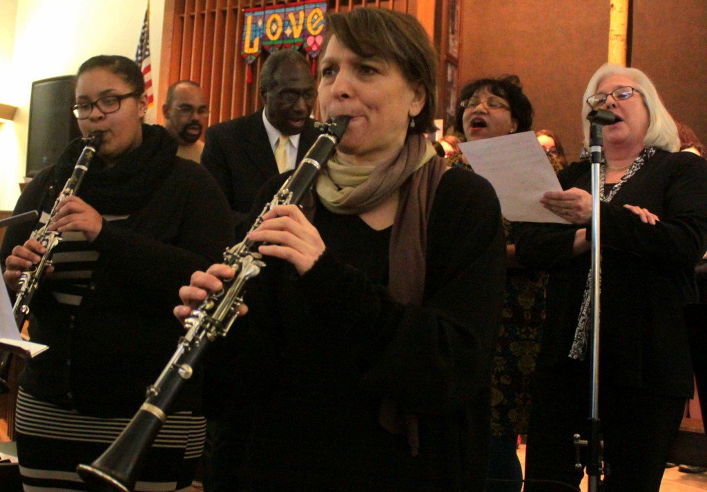 "Line Christensen and Robin Seletsky play "" O Mary Don't You Weep, Don't You Mourn"" while the the MLK Chorus; TJ Wooden, Lee Fisher, Yolanda Sharpe and Denise Michaelson provide vocals  during the Martin Luther King, Jr. Birthday celebration at the Elm Park Methodist Church on Sunday. The event was sponsored by the Oneonta area branch of the NAACP and the City of Oneonta Commission on Community Relations and Human Rights."