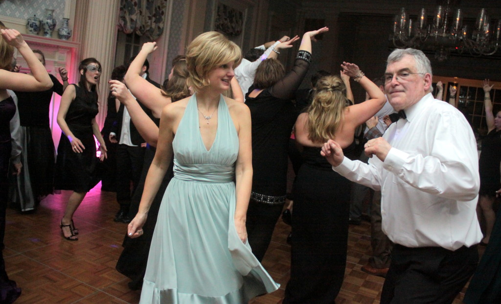 Roger Davidson, right, and his wife Maureen owners of Council Rock Brewry dance at the PTA Masquerade at the Otesaga Hotel on Saturday night. Revelers were treated to an exclusive American Farmhouse 5 Brew Ale, which was donated for the event by the Davidsons exclusively for the event.