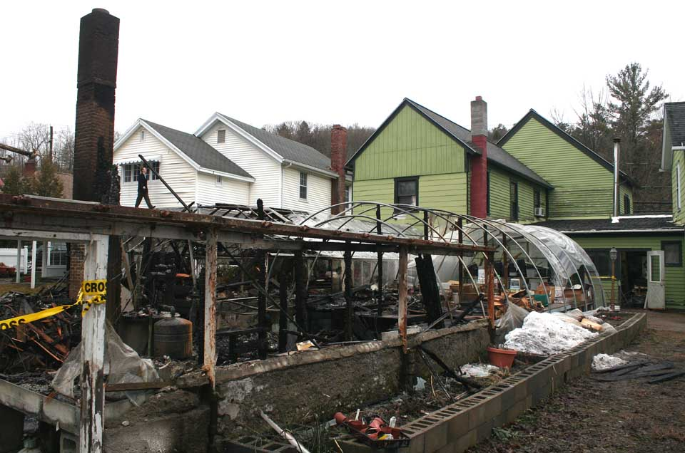 Charred remains and little more is all that's left of the greenhouse behind Mohican Flowers today.  The fire began in a cellar, in the foreground, where the oil burner was located.  (Jim Kevlin/allotsego.com)
