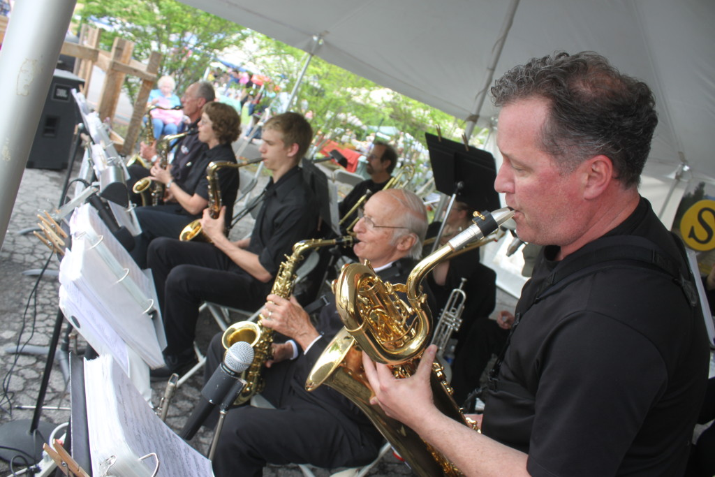 During Cooperstown's Spring Fling on Railroad Ave, the brass band kept the mood lively with their renditions of jazz standards. From right: Milo Stewart, Jr., Ed Bagley, Sean Mebust, Karen Dunlap and Arnie Junkind.  (Ian Austin/allotsego.com)