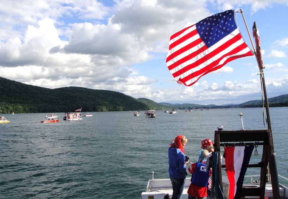 The Otsego Lake Association's webmaster Tim Pokorny sent along images of the OLA's second annual Fourth of July Boat Parade, which sailed from Three Mile Point last evening, passed Cooperstown's Lake Front Park, then went back to its beginning.  Tim also sent a link to more photos.