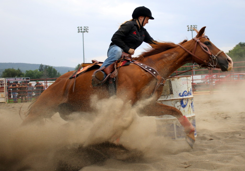 The makeshift rodeo ring made for tricky maneuvering for the riders and there horses. Here, Courtenay Chambers, Jefferson, rides her horse through a tight turn during the barrel races. (Ian Austin/ AllOTSEGO.com)