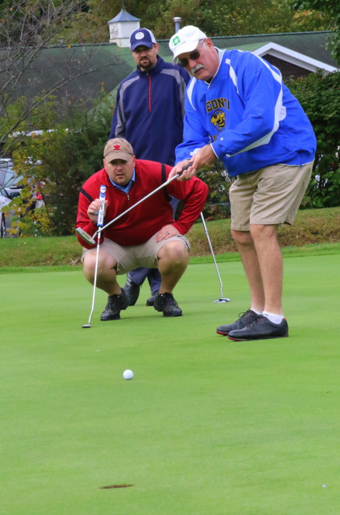 Thomas Harrington, OHS '72, tries for a put on the green under the watchful eyes of Zach Brown, '95, and Heath Ulter, '95, during the OHS Alumni Golf tournament at the Oneonta Country Club this morning. The event, which featured 29 teams, kicked off a weekend of events and celebration in honor of OHS Alumni weekend. (Ian Austin/ AllOTSEGO.com)