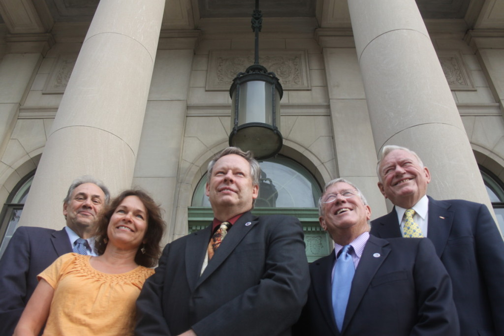 It was a proud day – Sept. 7, 2012 – when four mayors posed with Oneonta's first city manager, Mike Long, on City Hall's steps. From left are John Nader, Kim Muller, Long, Dick Miller and David W. Brennan. Let's recapture that feeling.