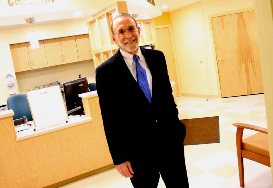 Dr. William Streck, Cooperstown, stands in the lobby of the newly completed William F. Streck Health Center, named in his honor at tonight's reception at Pathfinder Village. The Bassett clinic, which opens to the public on Monday, Nov. 9, features five exam rooms, a considerable upgrade from the former Edmeston clinic, a one-room space in a converted farmhouse. In addition to serving the public, the clinic will also provide Pathfinder residents with access to dental care. (Ian Austin/AllOTSEGO.com)