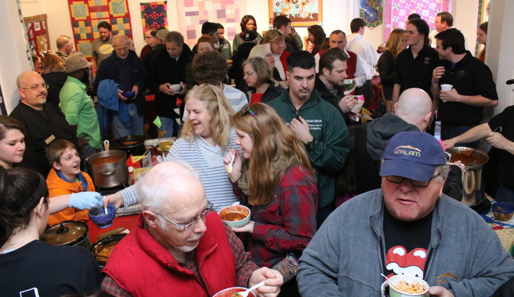 Chili artisans brought out droves of food lovers to the ever popular Chili Bowl at CANO this afternoon. The event, celebrating its 12th year, boasted chilis for any taste. The event, the main CANO fundraiser sold over 430 bowls made by local artisans at the nearby Carriage House Art Studio. This year's winners were the Oneonta Bagel Company, who won the People's Choice award with their Bungalow Bills Bayou Chili, and Oneonta Hots, who took home the Fireman's Choice award. (Ian Austin/AllOTSEGO.com)