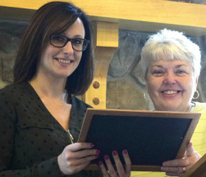 Felicia Weaver, left, receives Arc's Employee of 2015 Award from Executive Director Pat Knuth.