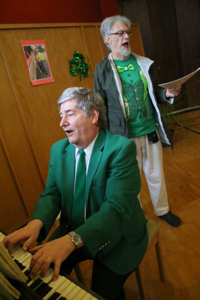 "Dr. Craig Marrow, Cooperstown, on piano, and Jim Hanson, Oneonta, lead the dinner revelers at St. James' Irish Night dinner in a rendition of ""Sweet Rosie's Baby."" Guests enjoyed traditional Irish fair, as well as a performance by the Damsha Beatha Irish Dance Troupe. (Ian Austin/AllOTSEGO.com)"