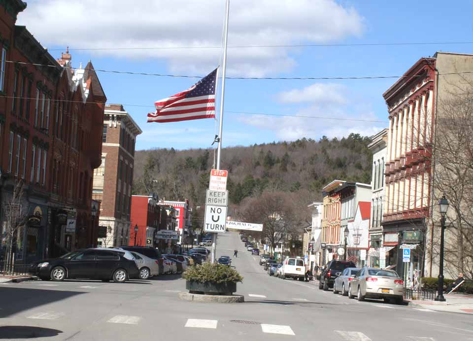 The flag at Main and Pioneer in downtown Cooperstown was lowered this morning to half-staff in remembrance of CCS Superintendent of Schools C.J. Hebert, who died in a four-wheeler accident on Sunday In Schoharie County. (AllOTSEGO.com)