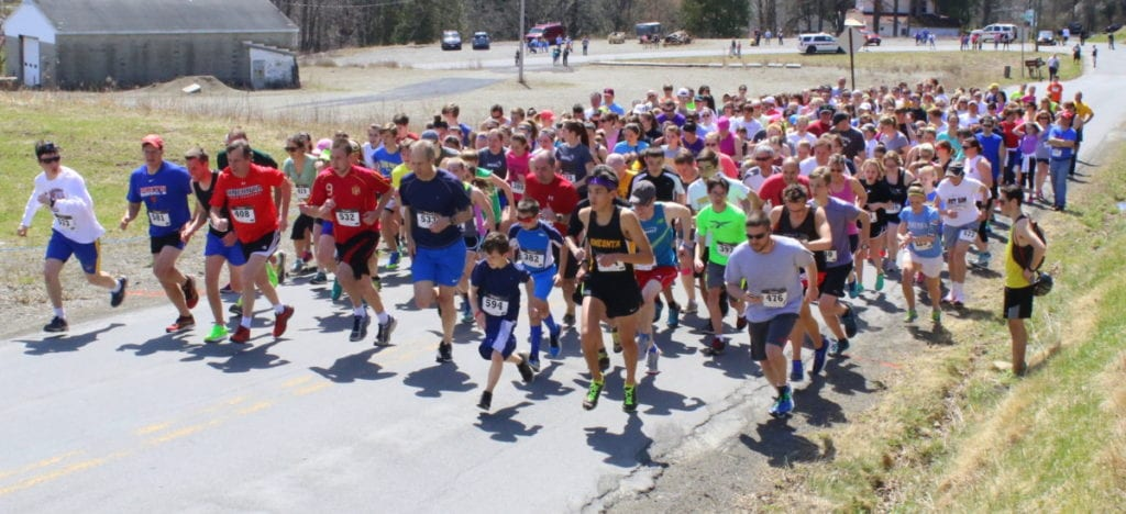 Alex Kahl, Mike Hamilton, Scott Hornung, Steve Hornung, Tom Slicer, Richard Sloman, Paul Zimmer, and Adam Nichols lead the charge as 477 runners of the 18th annual 5k take off up East St. this afternoon. Mike Hamilton took fist place over-all with a time of 17:44. (Ian Austin/AllOTSEGO.com)