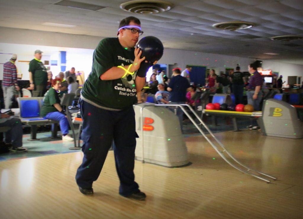 James Straney, Oneonta, sets up his throw at the 2nd annual Catch The Glow Bowl-a-thon at Holiday Lanes this afternoon. The event, Hosted by The ARC Otsego, had 17 teams who raised money for the Helping Hands Fund, which helps to cover unexpected costs by those receiving ARC Otsego services. Lanes were sponsored by local businesses and individuals. Glow necklaces, door prizes and silent auction kept the place buzzing til close. (Ian Austin/AllOTSEGO.com)