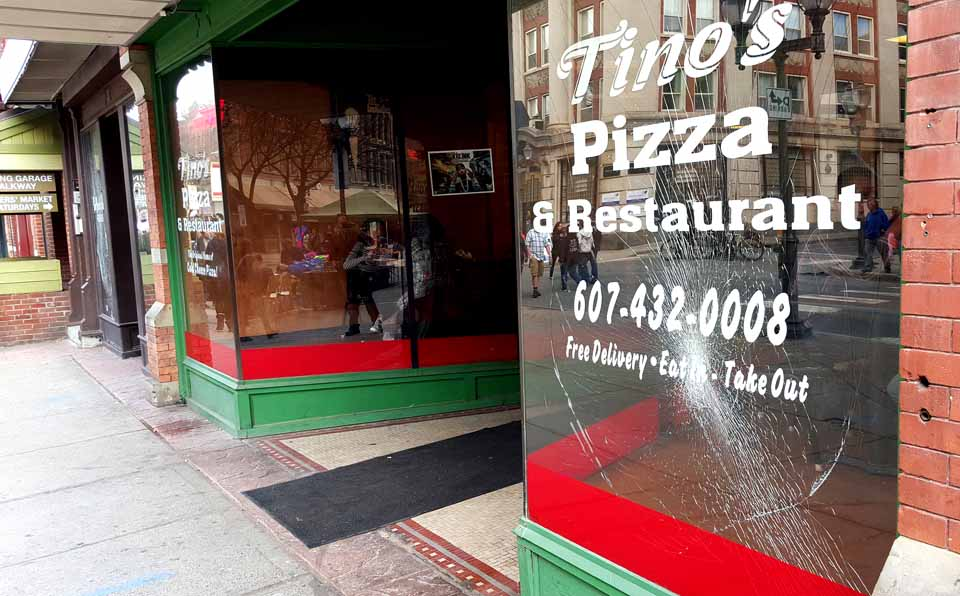 Windows at Tino's Pizza and two other downtown Oneonta businesses were broken overnight. (Ian Austin/AllOTSEGO.com)