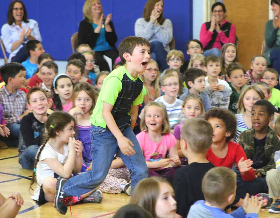 Jackson Forbes, a third grader at Greater Plains Elementary, was speechless when it was announced that his artwork had been chosen as one of 13 winners in New York to be featured in Casella's 2017 calendar. At a school assembly this afternoon, Adam Critti, sales representative for Casella,  awarded Jackson with a $25 TD Bank gift card, five copies of the calendar and a framed copy of his artwork.  Jackson is the first local winner of the contest to receive this honor. (Ian Austin/AllOTSEGO.com)