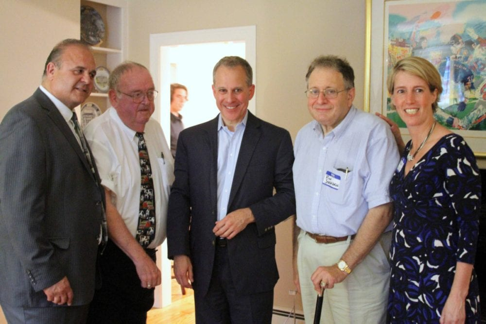 "State Attorney General Eric Schneiderman is in the Cooperstown area this weekend, posing here last evening at the annual county Democratic Dinner at Village Trustee Richard Sternberg's Westridge Road home.  From left are county Chairman Richard Abbate, Assemblyman Bill Magee, D-Nelson, Schneiderman, Dr. Sternberg and Zephyr Teachout, Democratic candidate for the 19th Congressional District.  This afternoon at 4, Schneiderman will appear at a Glimmerglass Festival forum, discusses the current applications of ""The Crucible.""  The operatic adaption of Arthur Miller's play is part of the festival's 2016 season."