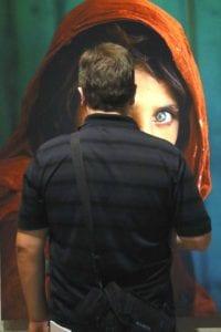 """Sharbat Gula,"" McCurry's most icon portrait looks back at Austin, eye to eye."