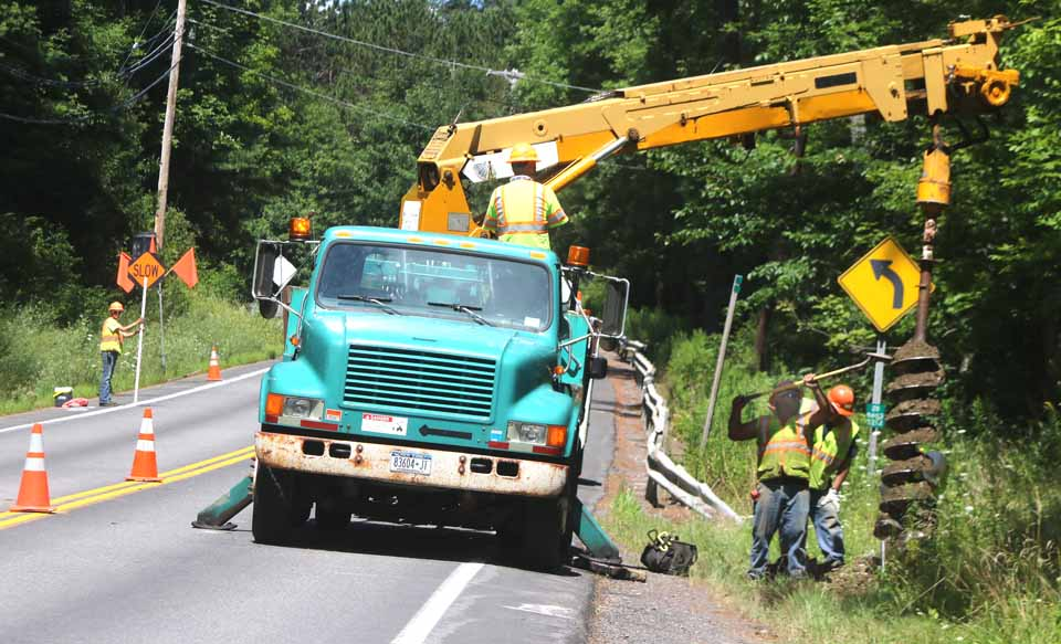 A DOT drew is auguring holes on each side of Route 28, south of Cooperstown, to install temporary traffic signals.  (Jim Kevlin/AllOTSEGO.com)