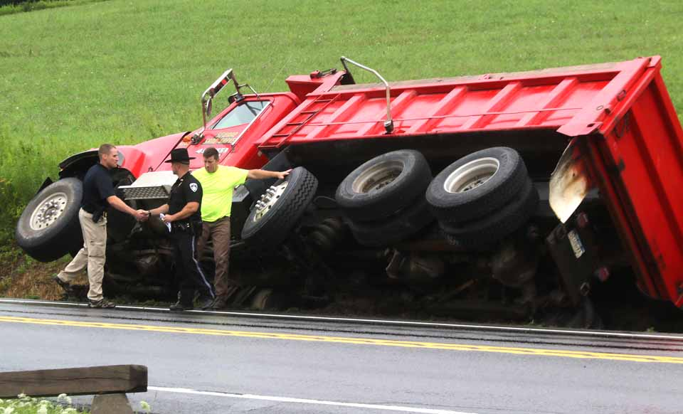 A Seward Sand & Gravel truck is on its side at thsi hour off the southbound lane of Route 28, across from Pop's Place.  Traffic south of Dreams Park is down to one lane at a time.  It appeared the truck slipped into a deep ditch on that side of the highway.  State police are at the scene, along with Hartwick Seminary fire police directing traffic.  (Jim Kevlin/AllOTSEGO.com)