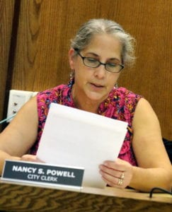 Nancy Powell, City Clerk, reads a letter from Karyl Sage pleading with the city not to destroy 27 Market Street.