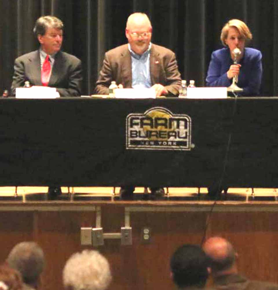 Congressional candidates at a Farm Bureau forum in Oneonta last May.  Republican John Faso is to the left of the moderator; Democrat Zephyr Teachout to the right.  (AllOTSEGO.com photo)