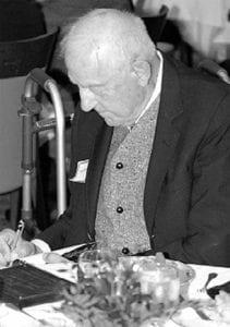 Henry S. Kernan signs copies of his book,