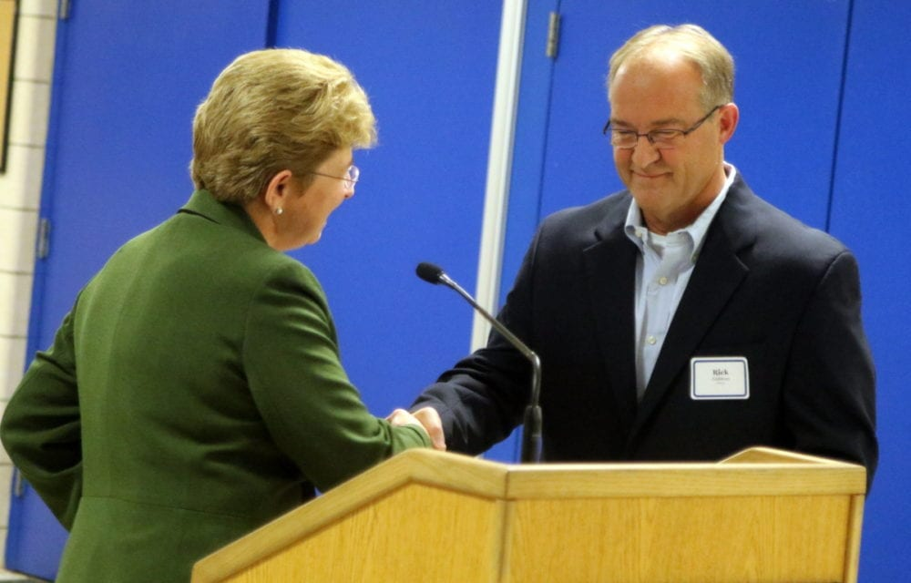 "Hartwick College has named their newly renovated locker room in honor of the late Dick Miller. A dedication was held outside Binder Gymnasium this evening where friends and family gathered for the ceremony. Here, Hartwick President Margaret Drugovich shakes the have of Rick Eastman, who made the renovations, and was close friend of Miller. ""Dick Miller was the reason that we became involved in Hartwick. He lived and breathed it."" recounted Eastman in his speech. Tours were givenof the new locker rooms which included a mural, wooden lockers, new shower rooms and more. (Ian Austin/AllOTSEGO.com)"