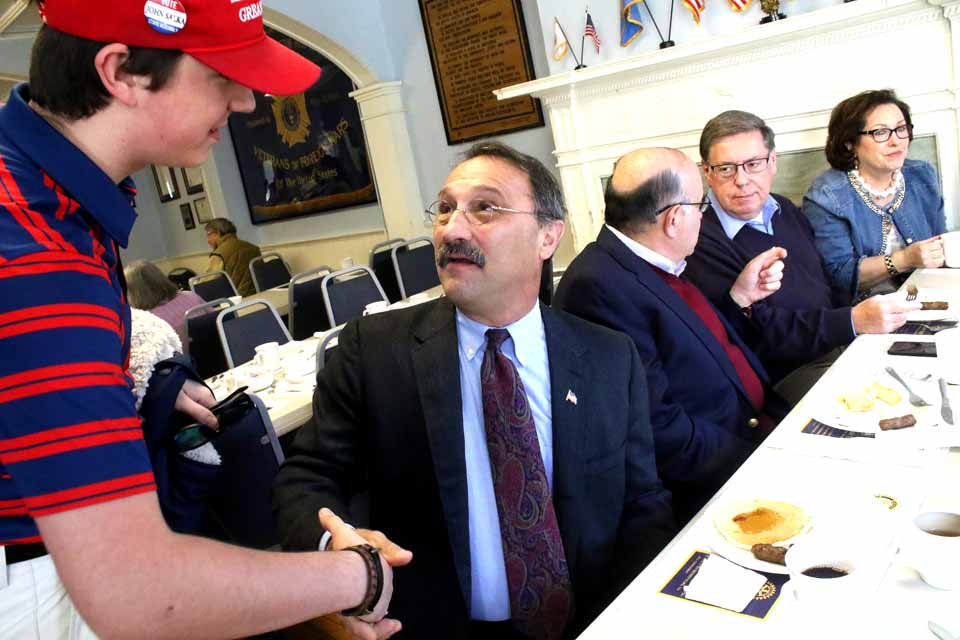 John Salka, the Brookfield town supervisor and Madison County legislator who is challenging Assemblyman Bill Magee, D-Nelson, for hte 121st District seat, shakes hands with Bobbie Walker, founder of the Otsego County Young Republicans, at the Cooperstown Rotary Club's pancake meal at the Vet's Club. Behind him is Tony Casale, the retired assemblyman, and state Sen. Jim Seward, R-Milford, and wife Cindy. Seward is being challenged by Democrat Jermaine Bagnall-Graham of Sherburne. Also on the ballot are Republican John Faso and Democrat Zephyr Teachout, vying to succeed Congressman Chris Gibson in the 19th District. (By the way, the Rotary is serving pancakes until 2 p.m., and again from 4 to 7 p.m.) (Jim Kevlin/AllOTSEGO.com)