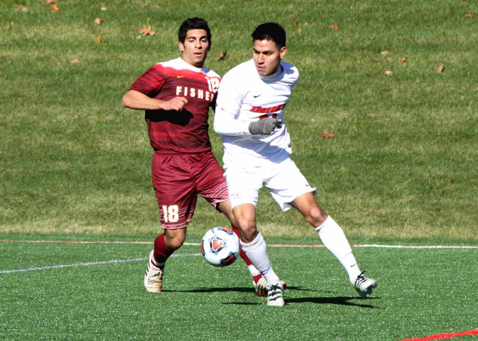 Oneonta State's Carlos Martinez plays the ball in front of St. John Fisher's Louis Guiliano during the first half Saturday. The Red Dragons' Hans Purtell scored a second half goal to give Oneonta a 1-0 win in the opening round of the DIII NCAA Men's Soccer tournament. Oneonta plays again in the 2nd round tomorrow at home against Eastern University, with a 1 p.m. start time.