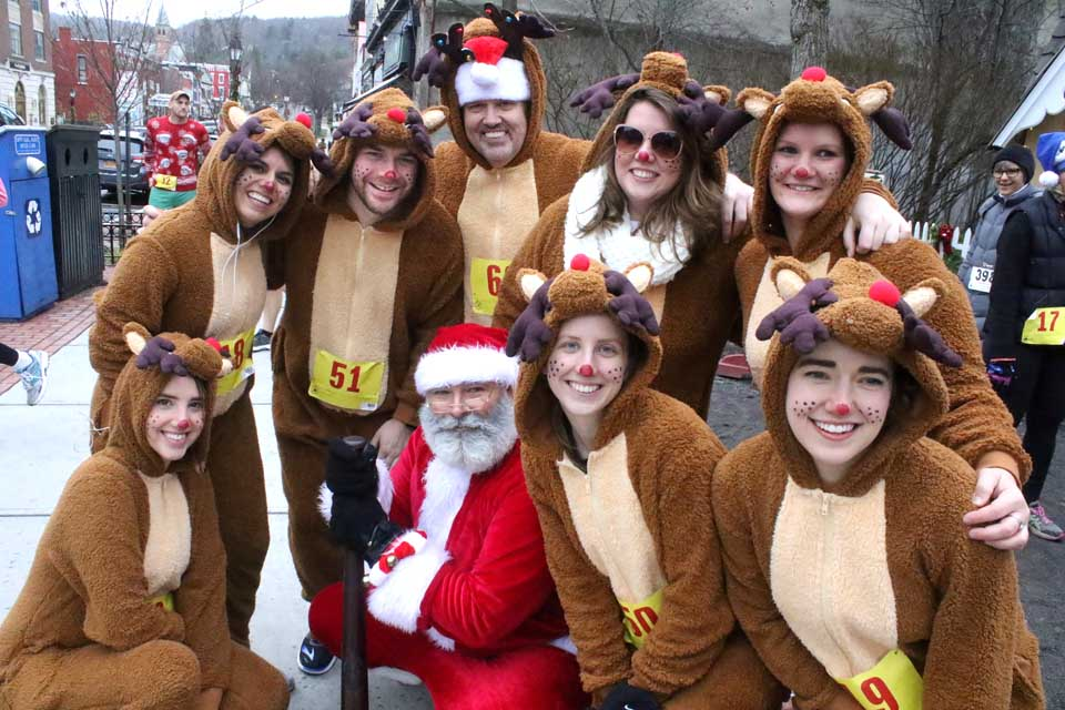 "Brian Wrubleski and a team from Mel's won a top prize in today's third annual ""Rockin Around Cooperstown Ugly Sweater Run and Walk""Ugly Sweater 2K and 4K race this afternoon from Pioneer Park through the village to Lakefront Park, sponsored by the Cooperstown Chamber of Commerce and the Clark Sports Center. Front row, from left, are Natalie Wrubleski, Santa (Steven Zabroski), Jamie Brinkman and Alex Coffey. Back row, from left, are Emma Ryanmiller, Natha n Tweedie, Brian Wrubleski, Hannah Bergene and Shirley Tyler. (Jim Kevlin/AllOTSEGO.com)"