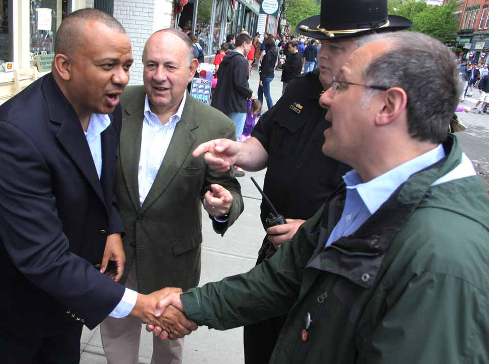 Chris Moss, ;eft. Republican gubernatorial candidate Rob Astorino's runningmate, is introduced to Cooperstown Mayor Jeff Katz, right, by Otsego County Sheriff Rich Devlin.  Moss, the Chemung County sheriff and president of the state Sheriff's Association, was being introduced to voters along Main Street during the Classic Parade by Tony Casale, the former assemblyman and adviser to state GOP Chair Ed Cox.  Moss was at The Otesaga last week for the county Republican Party's annual dinner.  (Jim Kevlin/allotsego.com)