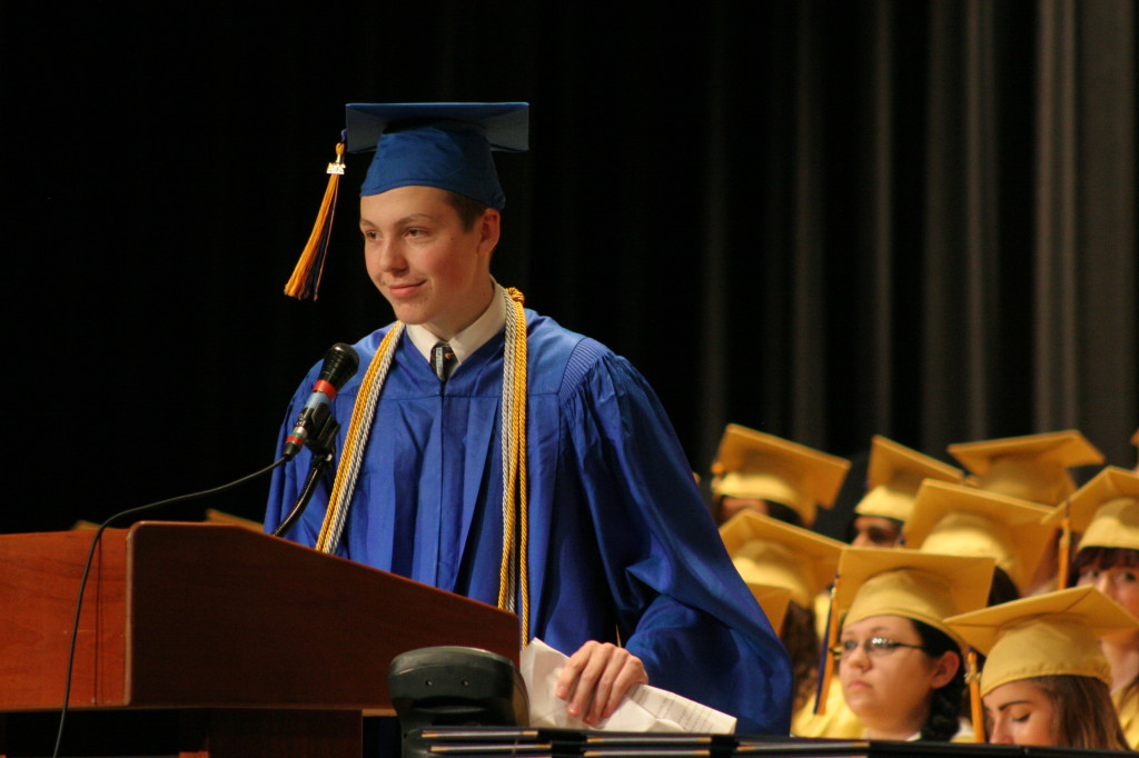 "OHS Veledictorian Chris Lentner addresses his graduating class, urging them to ""Vote, turn off electronics and live you life by taking risks, going places, and meeting people."""