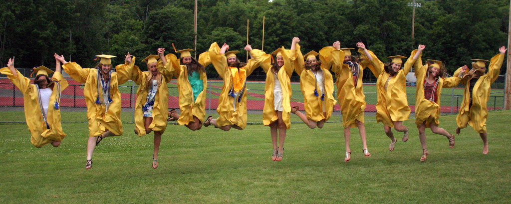 OHS 2014 Graduates Sylvia Montanti, Mariah Ruff , Kristen Wells, Brittney Herrick, Michaela Mancini,  Erica Mileski,  Emily Schultis, Margaret Burns, Marie Stiller, Ceili Getman, Maria and DiMartin  jump for joy on the lawn of OHS following the commencement ceremonies on Saturday morning.
