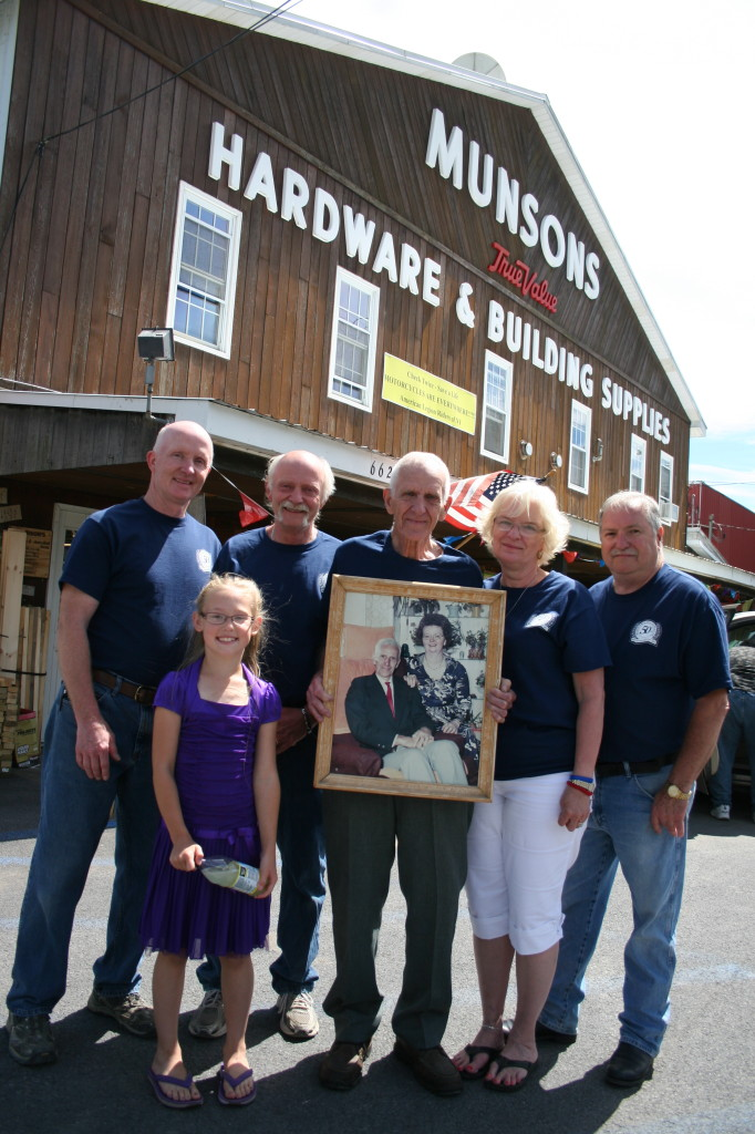 The Munson family and their employees celebrated the 50th anniversary of the business on Friday. Seen here are Michael Munson, Allison Munson, Steve Munson, Fred Munson, who holds a portrait of himself and wife Audrey who he founded the business with, Shirley Goble and Bob Goble.