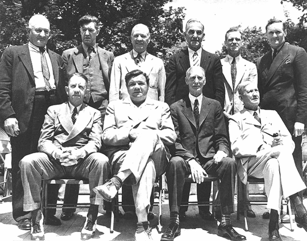 Ten Baseball Hall of Famers pose outside the museum in Cooperstown, June 12, 1939. Front row; Eddie Collins, Babe Ruth, Connie Mack, Cy Young. Back row: Honus Wagner, Grover Cleveland Alexander, Tris Speaker, Napoleon Lajoie, George Sisler and Walter Johnson.
