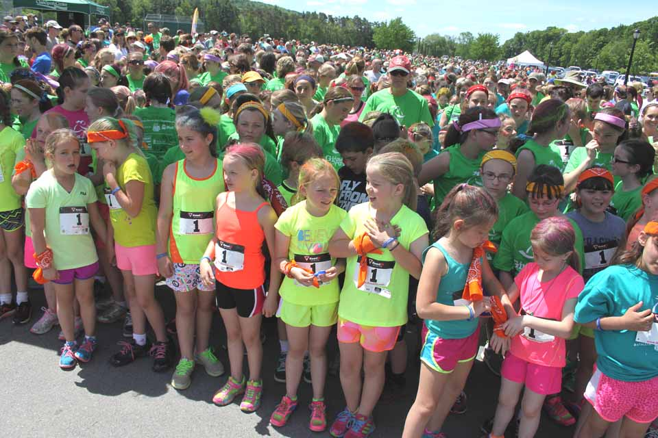 The Morris contingent, including Carissa Richards, 8, and Justine Morton, 9, in flourescent yellow T-shirts, were on the starting line at today's Girls on the Run 5K in Cooperstown.   More than 700 girls competed, plus 300 family and friends.  (Jim Kevlin/allotsego.com)