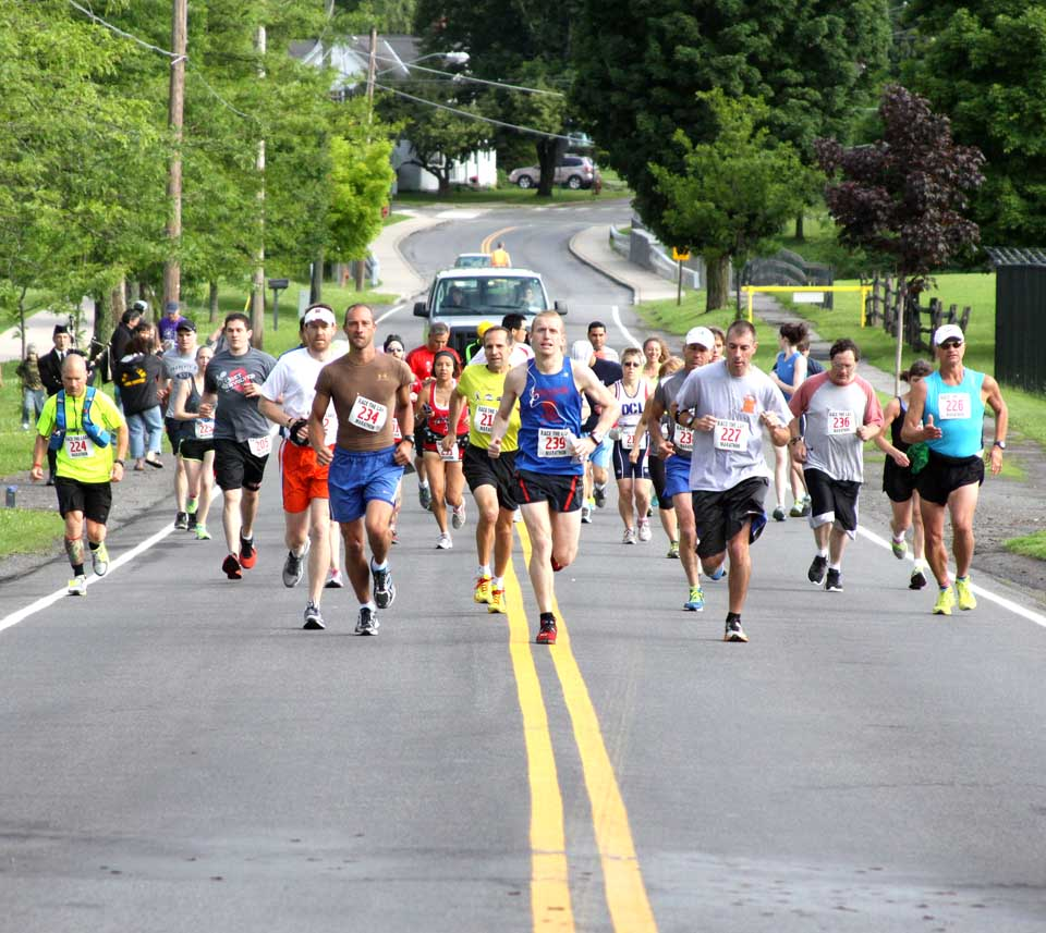 """...and they're off!  Cooperstown's first marathon, the """"Race Around The Lake,"""" begins at 8 a.m. on Susquehanna Avenue.  (Jim Kevlin/allotsego.com)"""