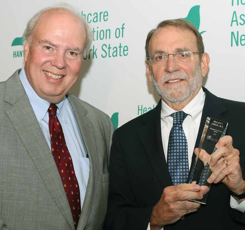 Dr. William F. Streck (right), CEO of Bassett Healthcare Network, accepts the Distinguished Service Award from HANYS president Dennis Whalen.  (Bassett photo)
