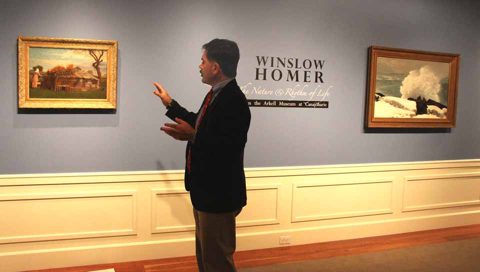 """NYSHA President Paul D'Ambrosio discusses Winslow Homer works that are being hung today in anticipate of Friday's opening of """"Winslow Homer: The Nature and Rhythm of Life"""" at The Fenimore Art Museum.""""  (JIm Kevlin/allotsego.com)"""