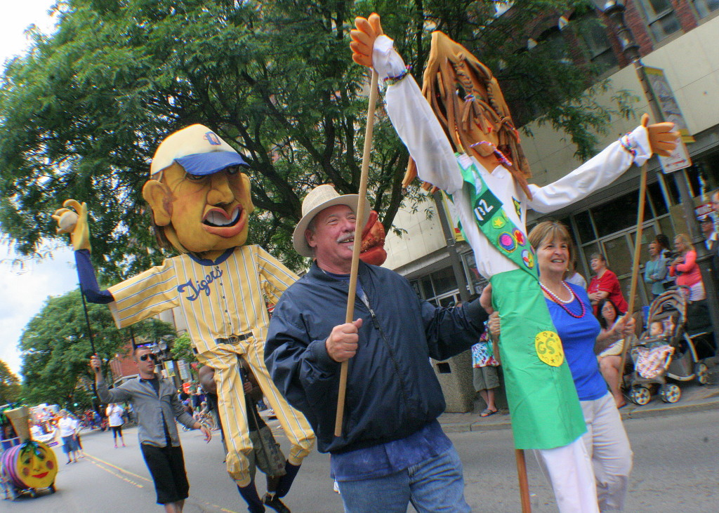 The July 4th festivities in Oneonta kicked off at noon with a parade down Main Street which featured dancers, skateboarders, classic cars and the FIrst Night puppets, seen here carried by Mike Krusinski and Debbie Barns of Sidney Center.