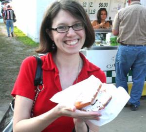 Reporter Libby Cudmore, allotsego.com's Fair Foodie, prepares to dive into a Deep-Fried Pop Tart.  (Chris Thorington for allotsego.com)