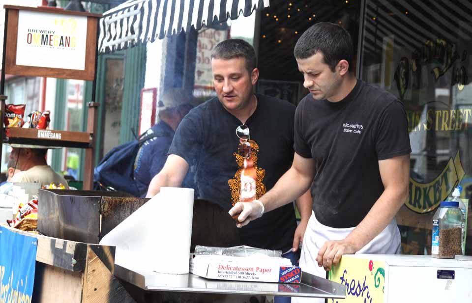 The smell of grilling Italian sausage is wafting up and down Main Street.  In front of Danny's, proprietor Phil Andrews (who also owns Nicoletta's, next door) was manning the grill himself.