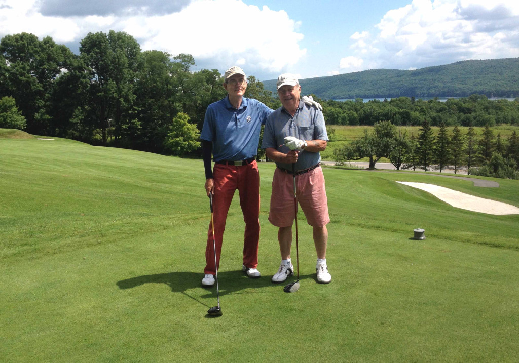 """Bill Coleman of Pierstown, right, hit his first-ever a hole-in-one at about 11 a.m. yesterday on the ninth hole of The Otesaga's Leatherstocking Golf Course.  Here, Tim Feury of Cooperstown, who was playing with Bill and Bill Glocker, offers congratulations. """"We knew he hit a good shot,"""" Glockler recounted, """"but we couldn't see it go in the hole because of the ninth green being elevated and it disappeared over a slight rise on the green.""""  When the trio got to the green, they discovered Coleman's ball in the cup.  It played 158 yards to an elevated green, so it was playing like 165-70,"""" said Glockler. """"It was very exciting and his first hole-in-one."""" (Bill Glockler photo)"""