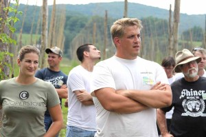 Lou Hager III answers tour members' questions at the Hager Hops yard in Pierstown.  At left is his sister Alicia, a partner in this venture.