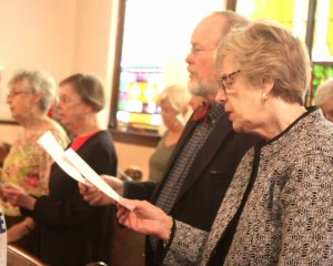 The Rt. Rev. Mark Sisk, retired Episcopal bishop of New York, and wife Karen join in the recessional hymn.  The Sisks retired to Jefferson, Delaware County, in 2013.