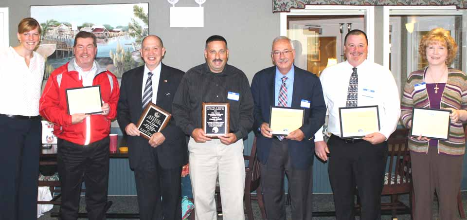 Frank Russo and Sheriff Mills, center, received the United Way's Alan Donovan Award from board president Sarah Manchester, left.  Honorees, from left are George Allen, Mills, Russo, Scott Davis, John Ray and Rev. Teressa Sivers.