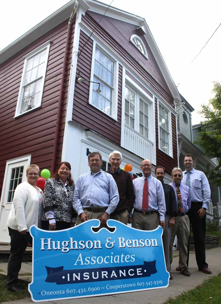 A grand opening of Hughson & Benson Insurance's Cooperstown office is underway at 59 Pioneer St. until 5 p.m. today.  Gathered at the 1840s fire house to greet visitors are, from left, Office Manager Tressa Decker, receptionist Madeline Sansevere, Senior Vice President Dan Root, longtime proprietor of the agency, Tom Hughson (now retired, President John Ryland, agents James Chiccorelli and Gary Jenning, and Richfield Springs manager Mike Gravelding.  (Jim Kevlin/allotsego.com)